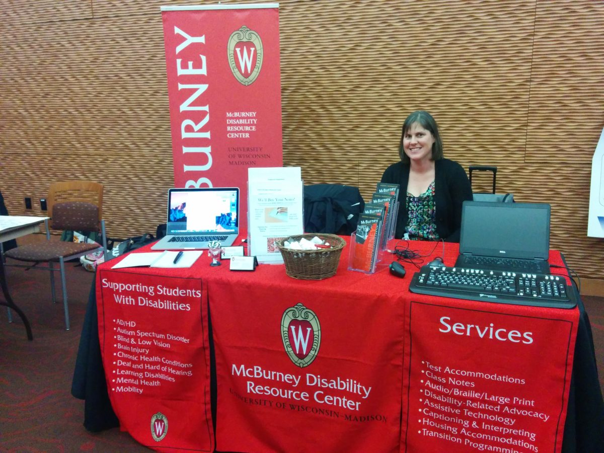 McBurney staff at information table at Adaptive Technology and Innovations Fair