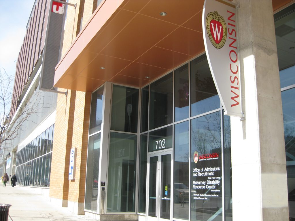 View of glass entrance doors to McBurney Center and Office of Admissions at 702 W Johnson St
